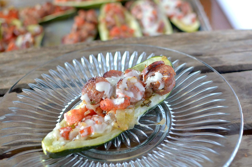Looking for an easy and quick dinner that your family will love? Make these Healthy Spicy Bruschetta Stuffed Zucchini Boats!