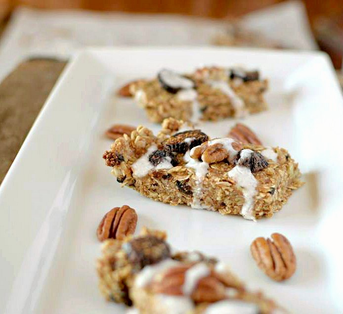 In need of a healthy snack that will satisfy you hunger as well as your sweet tooth? Make these No-Bake Pecan Fig Granola Bars with a Coconut Glaze that take no more than 10 minutes to make! Also Gluten-Free and Vegan!