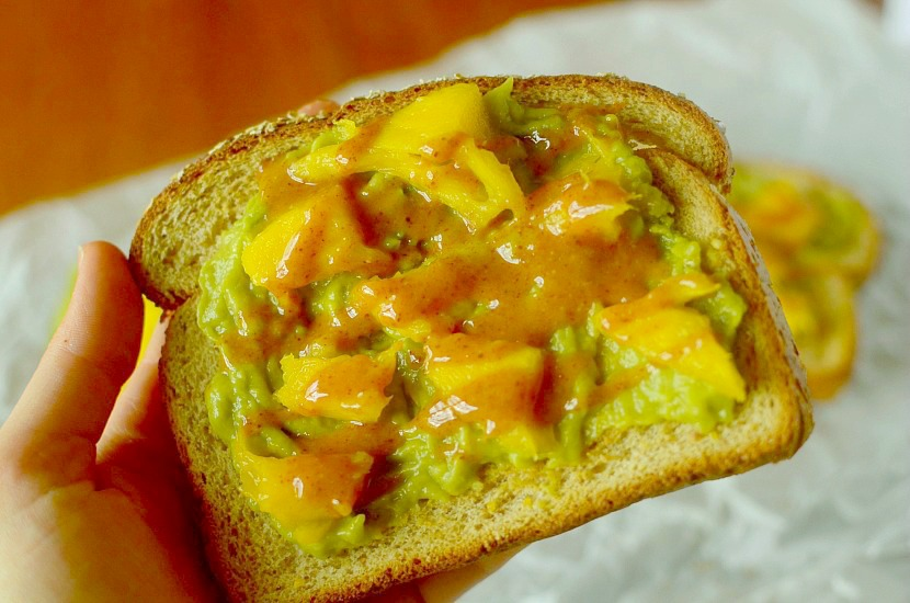 This Sriracha Mango Avocado Toast is a healthy and delicious breakfast or snack that is put together in less than 5 minutes and has a delicious almond butter-sriracha drizzle! Also can be paleo, vegan and gluten-free!