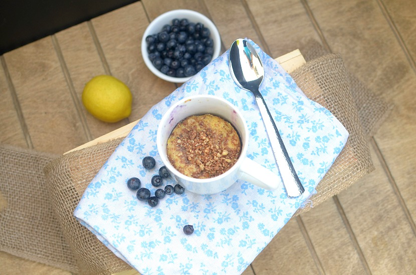 This Healthy Lemon Blueberry Crumb Cake In a Mug is a fast, easy and delicious breakfast, snack or dessert! It's the perfect summer treat made with real food ingredients such as almond flour, coconut sugar and fresh blueberries. Also paleo, gluten-free and has a vegan option!