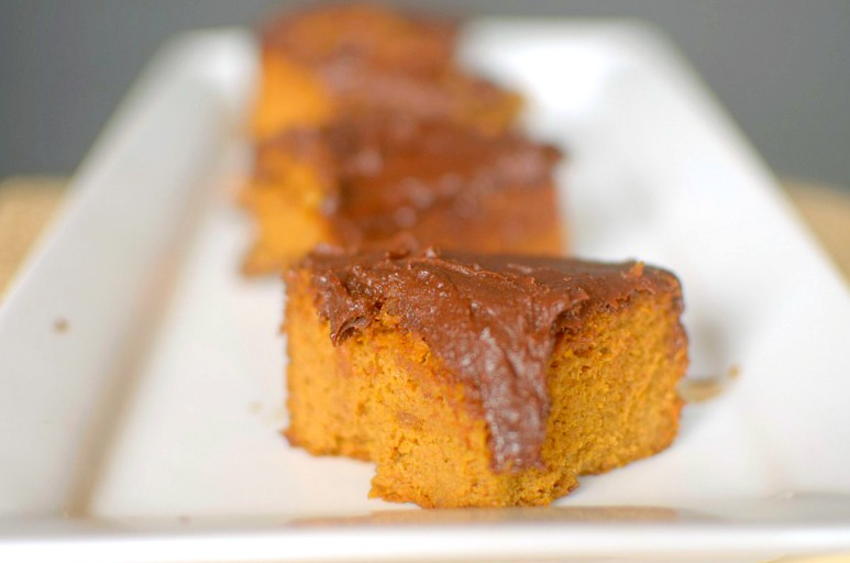 Satisfy your pumpkin cravings with this Paleo Pumpkin Snack Cake with Dark Chocolate Frosting. You won't believe that it's flour-less and made with only 7 ingredients! Also with a vegan option!