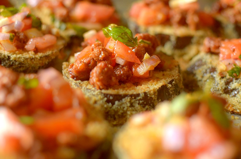 Whole 30 Spicy Chorizo Eggplant Bruschetta Eggplant Toasts are a great tasty entree that are filled with hearty, nourishing ingredients! Super easy to make!