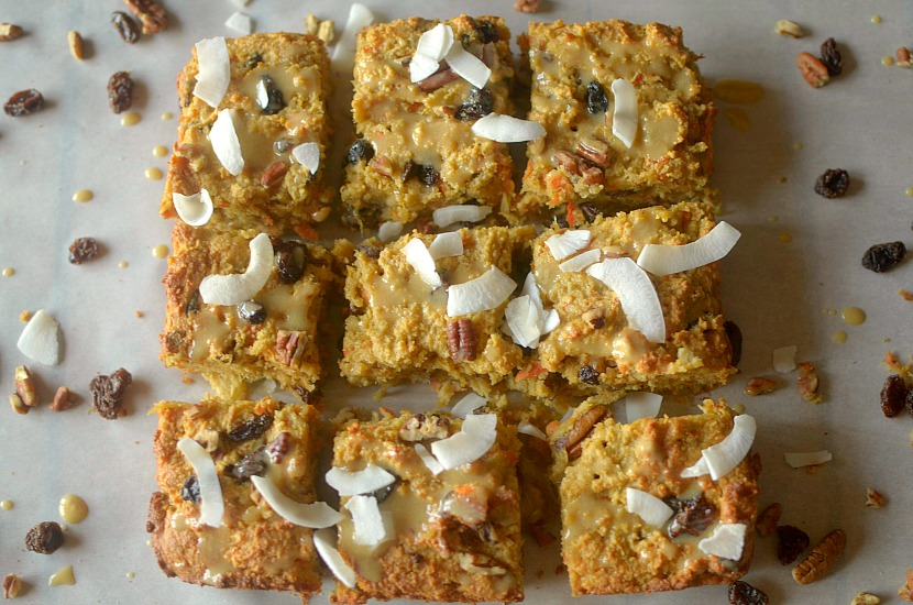 Healthy Carrot Cake Tahini Bread is a fluffy and delicious breakfast,snack or dessert filled with carrots, raisins, nuts and topped with a tahini-maple glaze! It's also paleo, gluten-free and vegan!