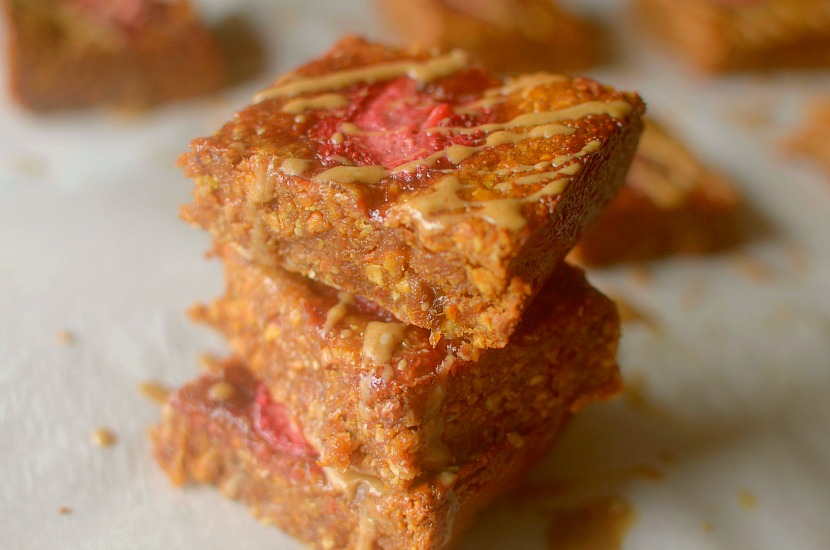 Need a healthy grab n' go breakfast? Make these delicious Almond Butter & Jelly Coconut Breakfast Bars for the perfect way to satisfy your early morning appetite! Paleo and Vegan friendly!